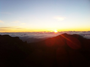 On top of the clouds watching the sun rise at Haleakala Crater.
